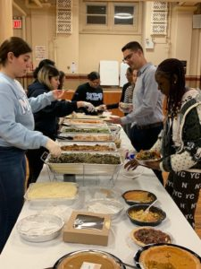 Area college students gathered at Assumption of the Blessed Virgin Mary to celebrate Thanksgiving.